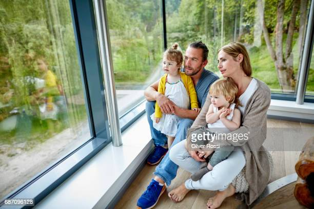Family looking out of the window together