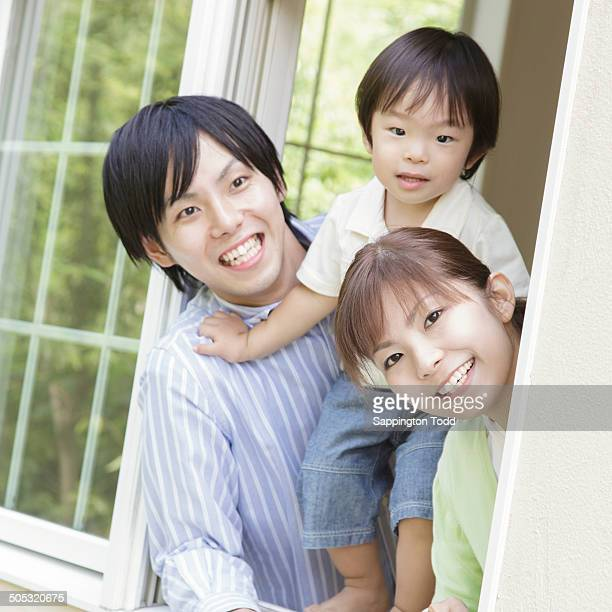 Family Looking Through Window