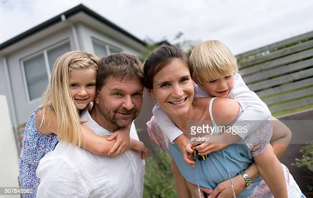 Family looking very happy outdoors