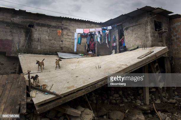 A family looks out at a portion of their collapsed home after a landslide in the Miraflores neighborhood of Mocoa Putumayo Colombia on Monday April 3...