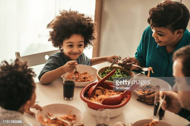 family lunch - evening meal stock pictures, royalty-free photos & images