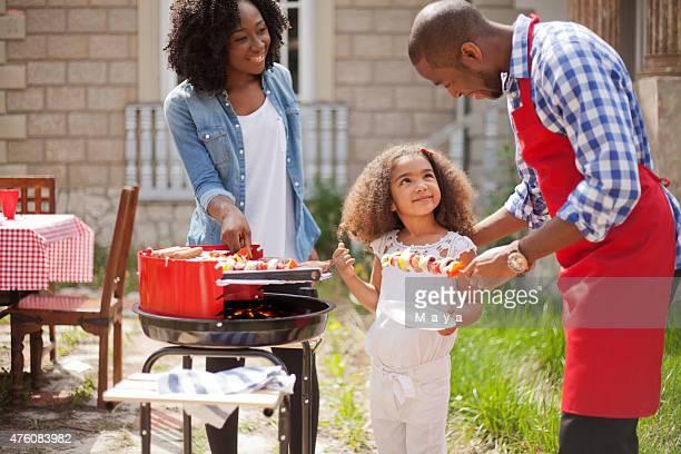 Family make barbecue