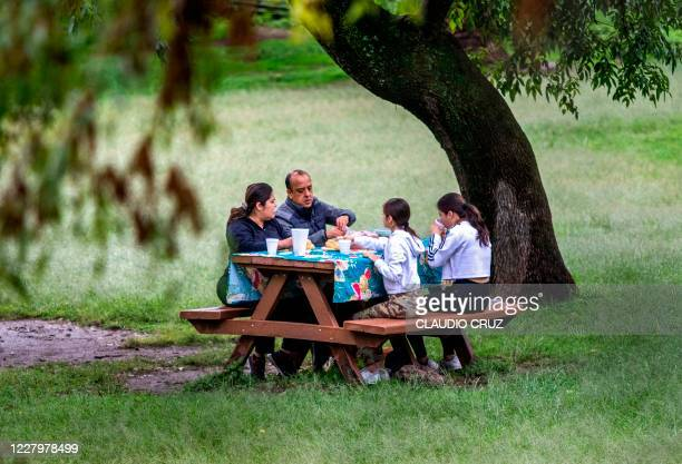 Family makes a picnic at the Chapultepec park in Mexico City on August 09 amid the COVID-19 coronavirus pandemic.