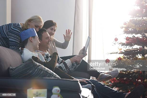Family making a video call on Christmas morning