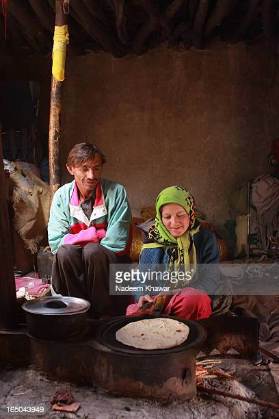CONTENT] Family making bread in the summer camp at Baba Ghundi Gojal Hunza Valley PakistanThis family visit this summer pasture every year from...