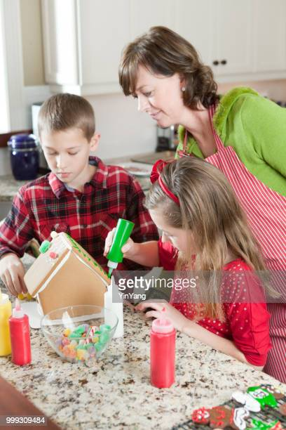 Family Making Christmas Cookies Together, Mother with Children Working in Kitchen
