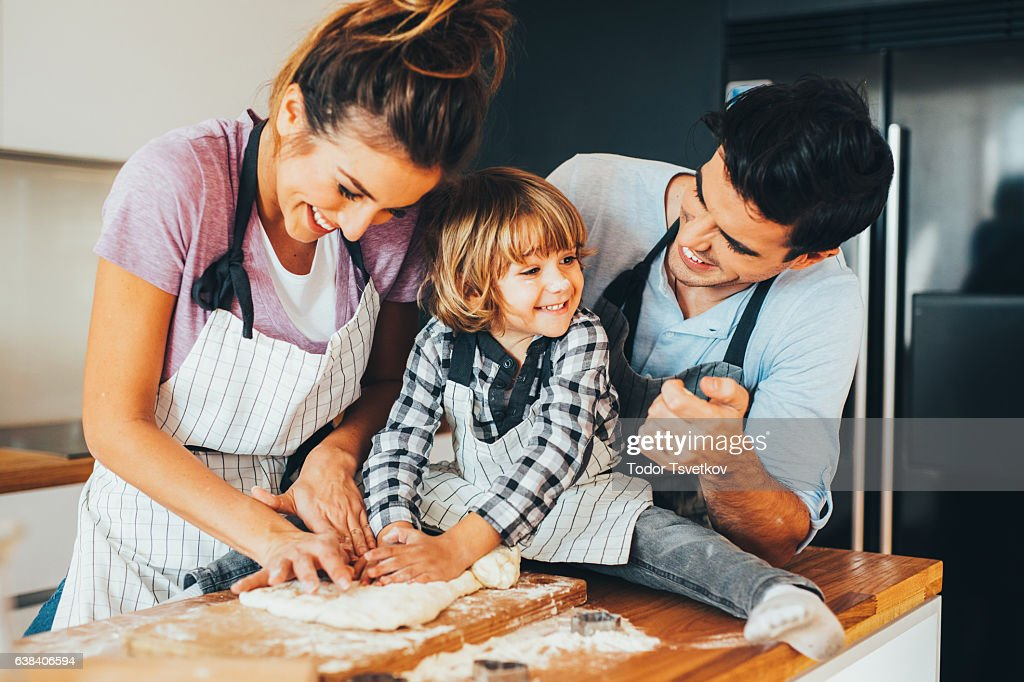 Family making cookies in the kitchen : Stock Photo
