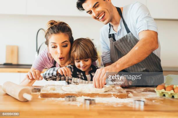 Family making cookies in the kitchen