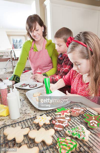 Family Making Decorating Christmas Cookies in Kitchen