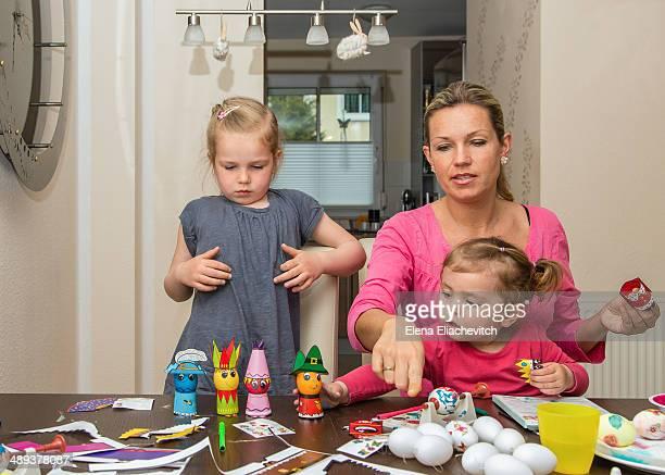 Family making easter eggs