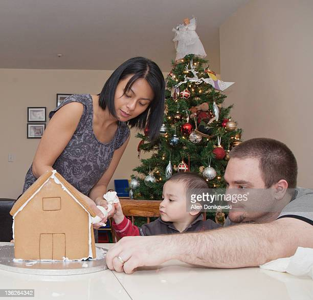 family making gingerbread house - filipino christmas family stock pictures, royalty-free photos & images