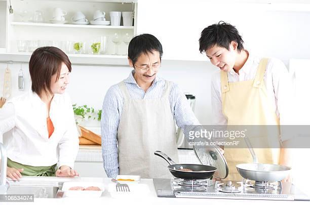 A family making hamburger stake