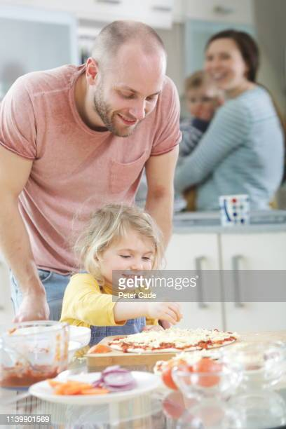 family making homemade pizza - sunday stock pictures, royalty-free photos & images
