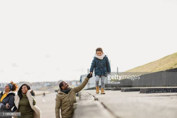 family making memories - warm clothing stock pictures, royalty-free photos & images