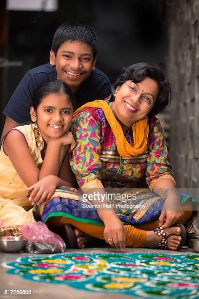 Family making rangoli for Diwali celebrations