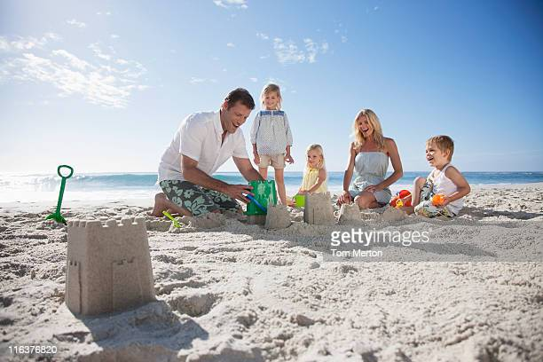 Family making sand castles on beach