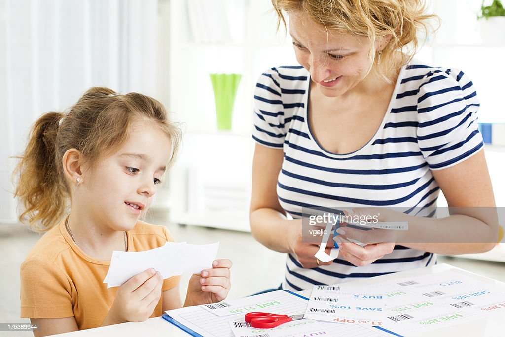 family making shopping list and coupons stock photo