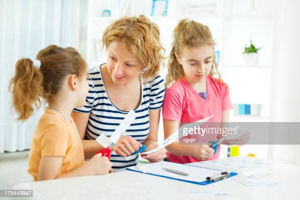 Family Making Shopping list and coupons.