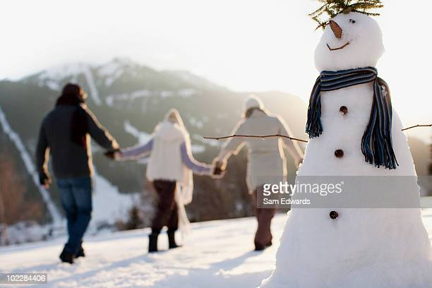 family making snowman - day stock pictures, royalty-free photos & images