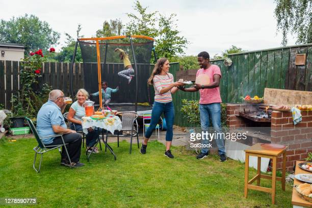 family making the most of summer - garden stock pictures, royalty-free photos & images