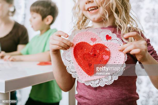 family making valentine's day cards - valentine card stock photos and pictures