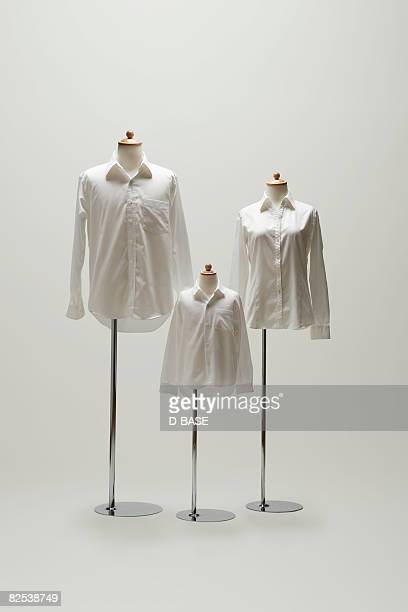 family mannequin dressing a white shirt. - white blouse stock pictures, royalty-free photos & images