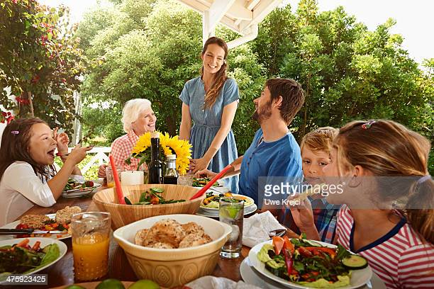 Family meal, outdoors