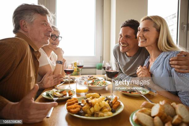 family meal - four people stock pictures, royalty-free photos & images