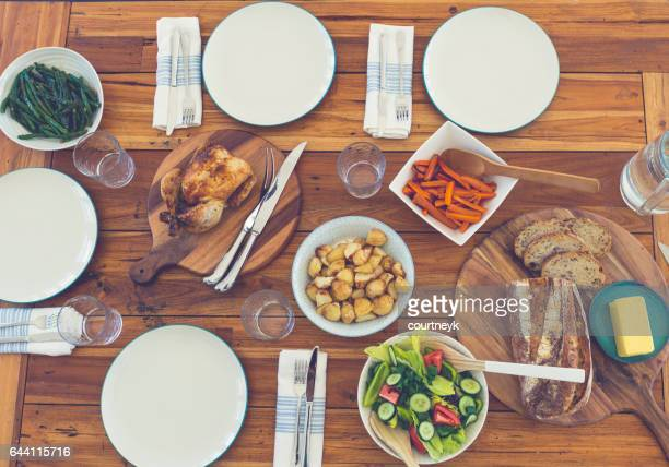family meal table with no people. - carving knife stock pictures, royalty-free photos & images