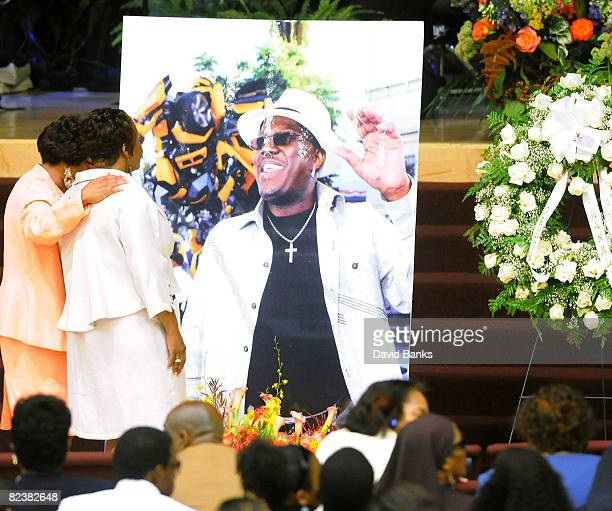 Family member consoles Bernie Mac's widow Rhonda McCullough at a memorial service for Bernie Mac at the The House of Hope Church on August 16, 2008...