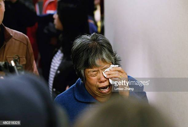 A family member of a passenger from the missing Malaysia Airlines flight MH370 reacts at Lido Hotel on March 24 2014 in Beijing China Malaysian Prime...