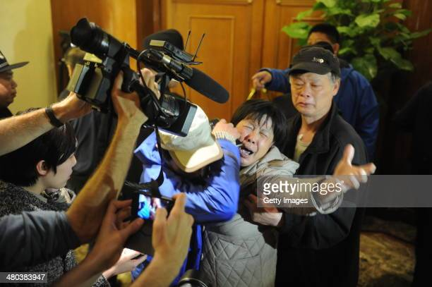 Family member of a passenger from the missing Malaysia Airlines flight MH370 reacts at Lido Hotel on March 24, 2014 in Beijing, China. Malaysian...