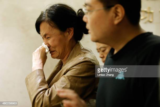 A family member of a passenger from the missing Malaysia Airlines flight MH370 shows her emotion at Lido Hotel on March 24 2014 in Beijing China...