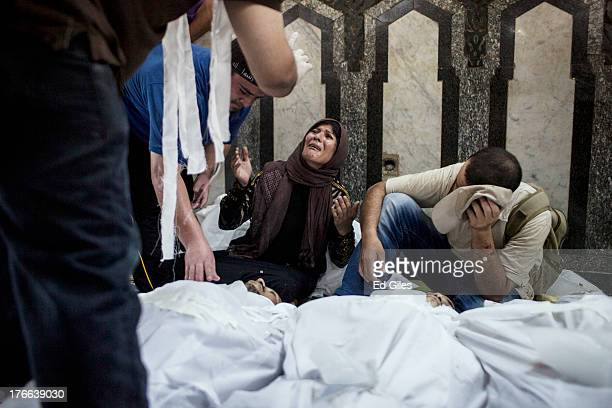 Family member of a supporter of deposed Egyptian President Mohammed Morsi killed during fighting with Egyptian Security Forces mourns at the Fateh...