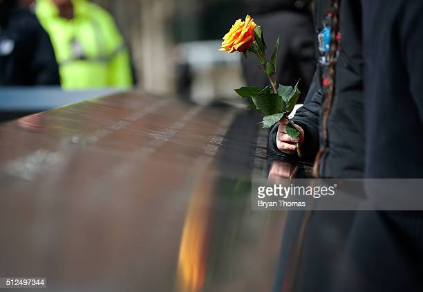 A family member of a victim of the 1993 World Trade Center bombing holds a rose at the 9/11 Memorial on February 26 2016 in New York NY On the the...