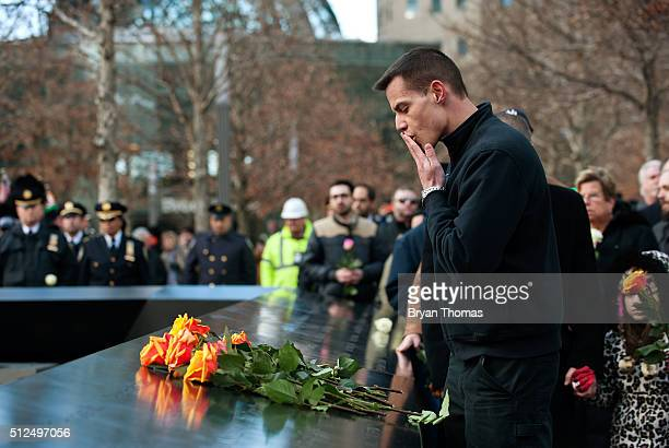 A family member of a victim of the 1993 World Trade Center bombing lays a rose at the 9/11 Memorial on February 26 2016 in New York NY On the the...