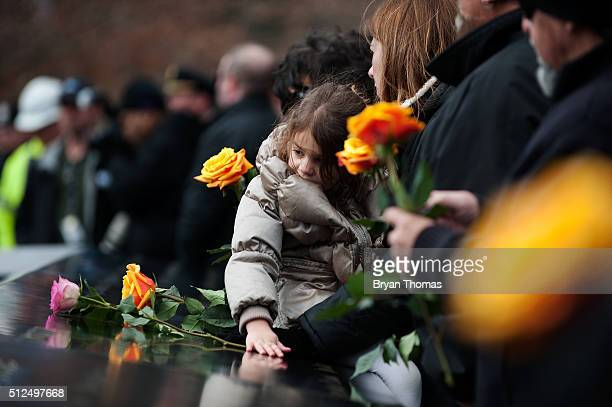 A family member of a victim of the 1993 World Trade Center bombing lays a rose at the 9/11 Memorial on February 26 2016 in New York City On the the...