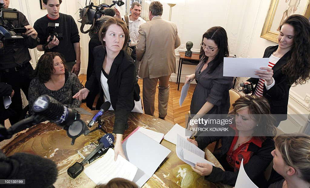 Family member of Karachi attack, Magali Drouet (C), leaves a press conference on June 16, 2010 in Paris. French policemen carried out a search at the end of May 2010 the Head of French Naval Constructions (DCNS) as part of the inquiry on Karachi attack in 2002.