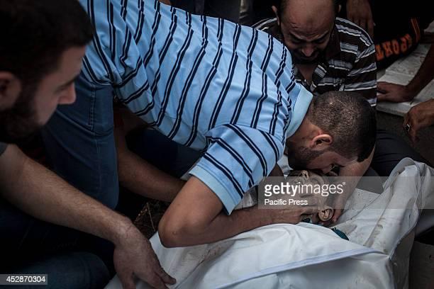 A family member of the child killed in an explosion mourns An explosion killed 10 people 9 of them were children in AlShati refugee camp park Israeli...