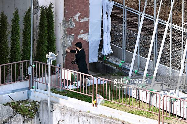 A family member of the victims touch a wall of an former apartment building which the derailed train crashed on the eleventh anniversary of the...
