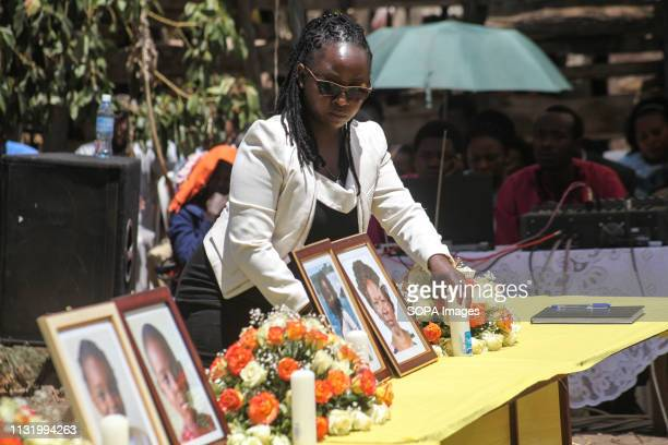 BAHATI NAKURU RIFTVALLEY KENYA A family member seen arranging portraits of her relatives during the memorial service Neighbors to the victims of the...