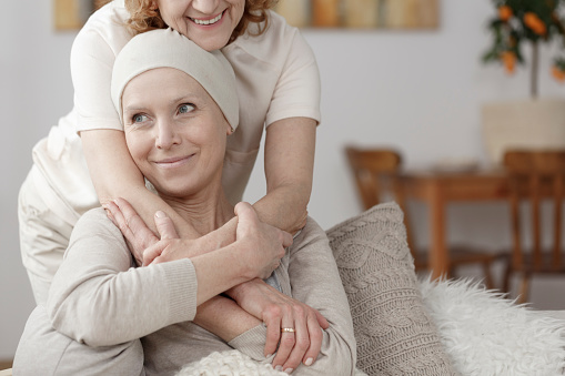 Family member supporting sick woman 910481044