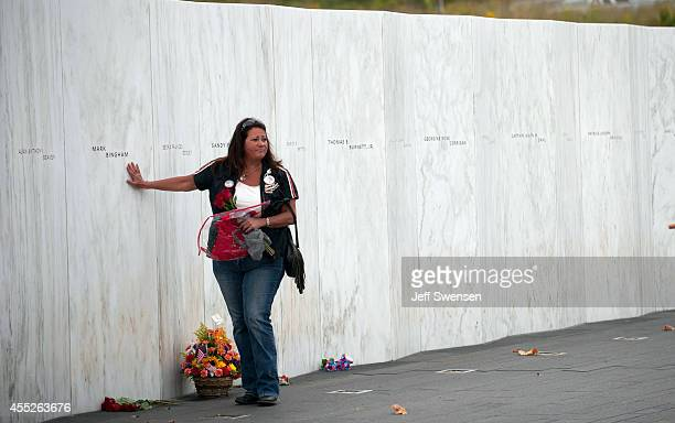 A family member touches the name of Mark Bingham during the 13th anniversary ceremonies commemorating the September 11th attacks at the Wall of Names...