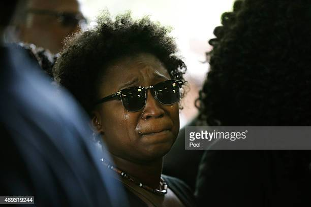 A family member weeps while entering the WORD Ministries Christian Center for the funeral of Walter Scott April 11 2015 in Summerville South Carolina...