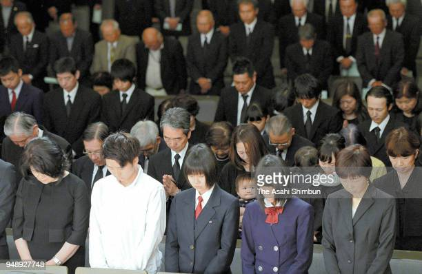Family memberes of the victims observe a minute of silence during the memorial ceremony of the Kumamoto Earthquakes second anniversary on April 15...