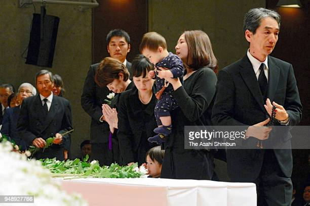 Family memberes of the victims offer flowers at an altar during the memorial ceremony of the Kumamoto Earthquakes second anniversary on April 15 2018...