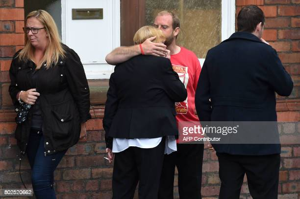 Family members affected by the 1989 Hillsborough stadium disaster comfort each other after being informed of the charging decisions by the...