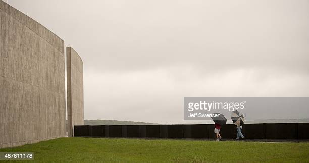 Family members and dignitaries brave the rain at the visitor center at the Flight 93 National Memorial on September 10 2015 in Shanksville...