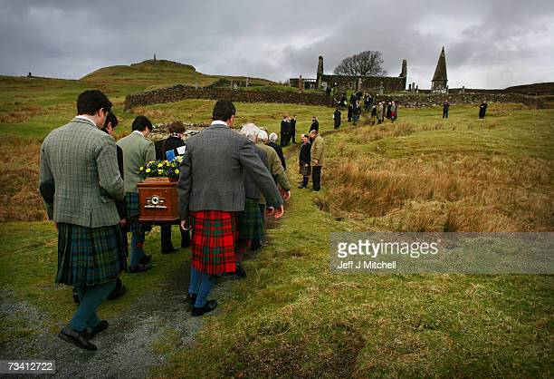 Family members and friends carry the coffin of Chief of Clan MacLeod John MacLeod into the burial ground at the old ruined church at Kilmuir Dunvegan...