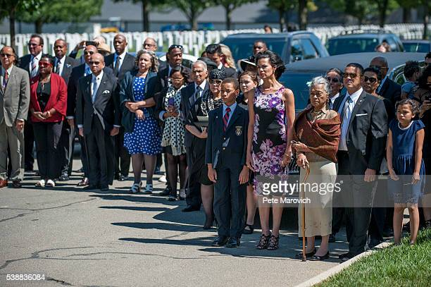 Family members and friends including John Glenn Jr daughter Fredricka Whitfield wife Nola Whitfield and son Lonnie Whitfield look on as the casket of...